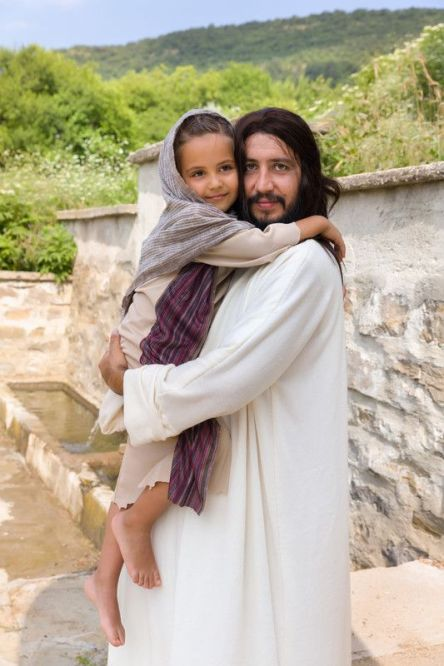 Jesus holding little girl